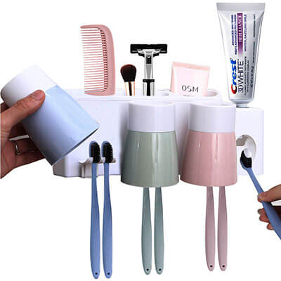 MEIJUBOL Toothbrush Holder Wall Mounted Automatic Toothpaste Squeezer